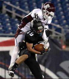 Foxborough, MA - 12/03/2016 - Magicians Sam Paquette (19) pulls down a long pass reception with Falmouth Clippers defender Samuel Koss draped all over him. MIAA Super Bowls: Division 2A Falmouth vs. Marblehead at Gillette Stadium in Foxborough. - (Barry Chin/Globe Staff), Section: Sports, Reporter: Karl Capen, Topic: 04HS Super Bowls, LOID: 8.3.862095835.
