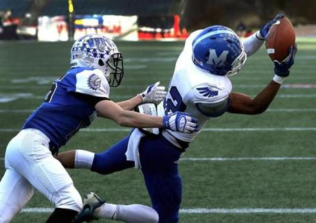 Foxborough, MA - 12/03/2016 - Mashpee wide receiver Devaun Ford, (22), pulls in a touchdown reception as Waconah's Dane Campbell, (16), defends. MIAA Super Bowls: Division 4 Mashpee-Wahconah at Gillette Stadium in Foxborough. - (Barry Chin/Globe Staff), Section: Sports, Reporter: Lenny Rowe, Topic: 04HS Super Bowls, LOID: 8.3.862095835.