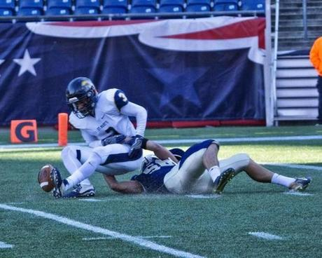 8.3.862095736_Sports_04d3abowl East Bridgewater defensive end Brian Damon (56) brings down St. Mary's of Lynn's Calvin Johnson (3) and causes him to fumble during the division 3a game at Gillette Stadium in Foxborough, Mass., Saturday Dec. 3, 2016. East Bridgewater defeated St. Marys of Lynn 34-8 to capture the title. (Robert E. Klein for the Boston Globe)