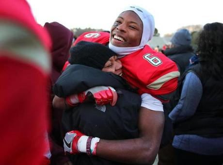 Lynn-12/03/2016- Division 1 Superbowl- Everett vs Xaverian - Everett's Jason Maitre gets a hug from his mother Ginette at the end of the game after Everett won the superbowl. John Tlumacki/Globe Staff (sports)