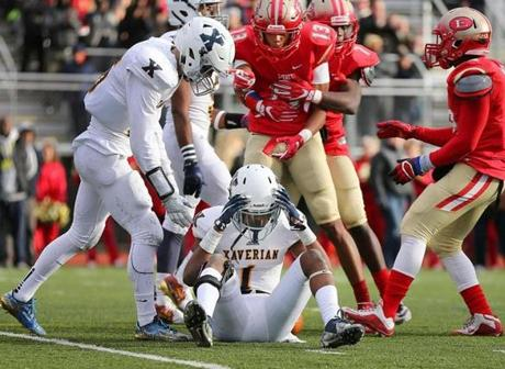 Lynn-12/03/2016- Division 1 Superbowl- Everett vs Xaverian - Xaverian's Samuel Laurent sits on the field upset with himself for dropping a pass near the endzone with seconds left in the 2nd qtr. John Tlumacki/Globe Staff (sports)