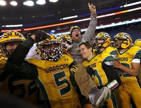 Foxborough, MA - 12/03/2016 - King Philip Warriors head coach Brian Lee is hoisted atop the shoulders of his players as the Warriors celebrate their Super bowl win over the Reading Rockets. MIAA Super Bowls: Division 1A Reading vs. King Philip at Gillette Stadium in Foxborough. - (Barry Chin/Globe Staff), Section: Sports, Reporter: Brendon Hall, Topic: 04HS Super Bowls, LOID: 8.3.862095835.