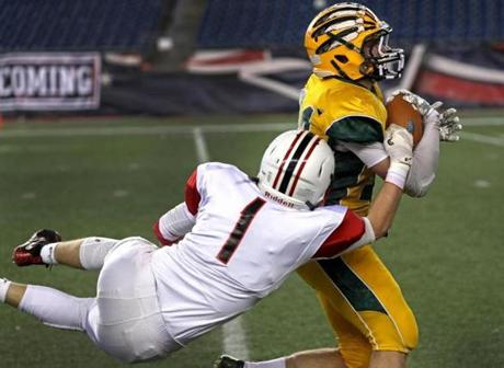 Foxborough, MA - 12/03/2016 - King Philip Warriors tight end Brett Mazur (34) sheds a tackle by Reading Rockets John Dimare (1) en route to a catch and run for a touchdown. MIAA Super Bowls: Division 1A Reading vs. King Philip at Gillette Stadium in Foxborough. - (Barry Chin/Globe Staff), Section: Sports, Reporter: Brendon Hall, Topic: 04HS Super Bowls, LOID: 8.3.862095835.