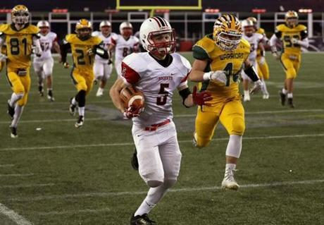 Foxborough, MA - 12/03/2016 - Reading Rockets running back Nick Dinapoli (5) struck first with a long run for a touchdown by Reading Rockets running back Nick Dinapoli (5). MIAA Super Bowls: Division 1A Reading vs. King Philip at Gillette Stadium in Foxborough. - (Barry Chin/Globe Staff), Section: Sports, Reporter: Brendon Hall, Topic: 04HS Super Bowls, LOID: 8.3.862095835.