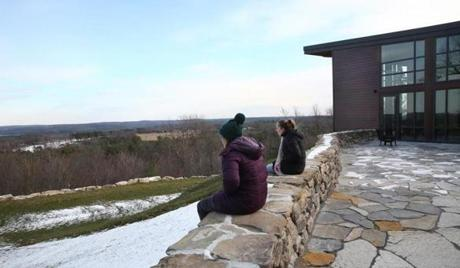 Virginia Peck-Phillips (right) and Sarah Gullong took in the scenery until the cold ushered them back to the retreat.