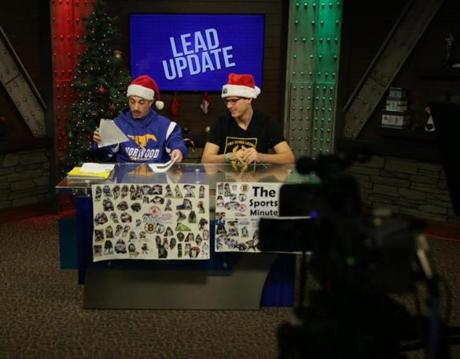 Norwood Ma- 12/15//2016 Lead Update host Antonio DiCesare (cq) left and Brian Curley (cq) right at the Norwood Public Access TV studio at Norwood High School. The TV studio is insidethe school where students learn how to produce TV shows in the Leade Program. Jonathan Wiggs /GlobeStaff) Reporter:Topic