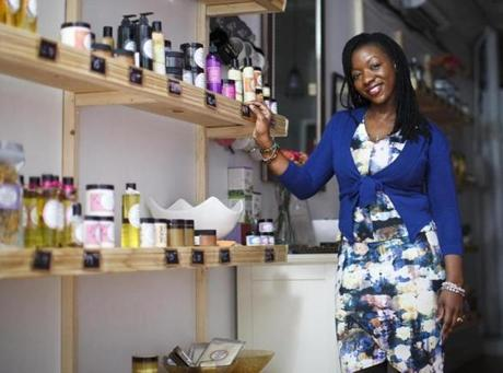 Boston, MA - 12/22/2016 - Faithlyn Scarlett stands in her store Faith's Naturals Beauty in Boston, MA, December 22, 2016. The store sells hair and skin products made of all natural products. (Keith Bedford/Globe Staff)