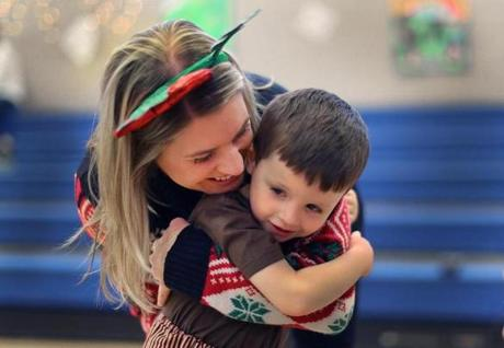 Randolph-12/22/16 The Boston Higashi School held their annual Winter Music Festival. Teacher Janell Palleschi hugs students Charles Dawson, 5 before the start. The school has a unquie approach to teaching children with autism incorporating arts and music into their programs. John Tlumacki/Boston Globe(metro)