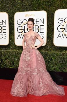 Actress Lily Collins arrives at the 74th annual Golden Globe Awards, January 8, 2017, at the Beverly Hilton Hotel in Beverly Hills, California. / AFP PHOTO / VALERIE MACONVALERIE MACON/AFP/Getty Images