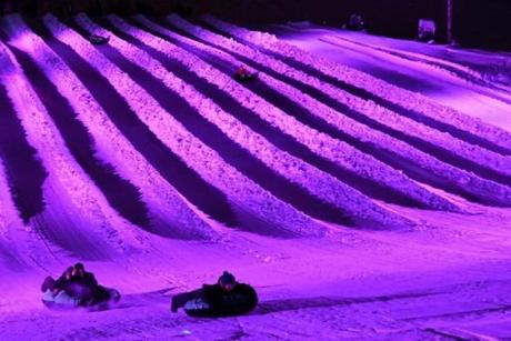 Cosmic Tubing offers riders 12 lanes of tubing accompanied by music and a rainbow of LED lights.