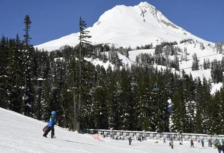 The 11,250-foot volcanic peak of Mount Hood rises above the ski resort.