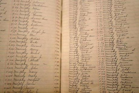 BOSTON, MA - 1/10/2017: A detail of names in a record book....The Historic Catholic Records Online project, made possible through a collaboration between NEHGS and Archdiocese of Boston-Presentations by top officials of NEHGS and the Archdiocese will provide complete details and a live demonstration of this unique and historic collaboration which will make the largest online collection of 18th and 19th century American Catholic sacramental records available to the public. The records which document baptisms, confirmations, marriages, and other sacraments cover more than 150 parishes from throughout eastern Massachusetts, as well as sacraments that were carried out in other locations in New England (David L Ryan/Globe Staff Photo) SECTION: METRO TOPIC 11history