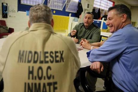 From left: Faherty spoke with Paul Connor, veteran services coordinator, and Middlesex County Sheriff Peter Koutoujian at the jail earlier this month.