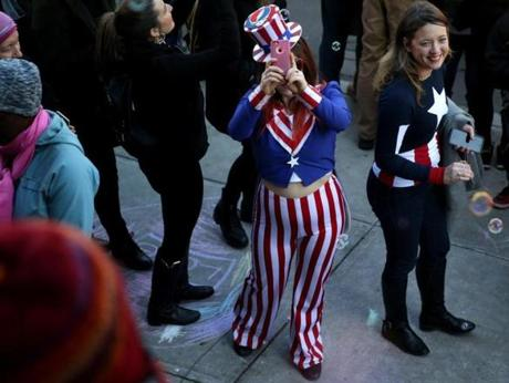 A woman in a Uncle Sam costume grabbed a few pictures.