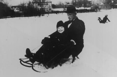 OPS photo by kennedy family bw unknown kennedy once the kennedys relized that rosemary was retarded they hired tutors to teach her how to print play tennis ride a bike read and dance . she is shown sledding with godfather, eddie moore.