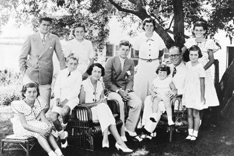 1934 / Photo by Bachrach / The Kennedy family in Hyannisport. Standing: Joseph Jr., Kathleen, Rosemary, Eunice Sitting: Patricia, Robert, Mrs. Rose Kennedy, John, Edward, Mr. Joseph P. Kennedy Sr., and Jean