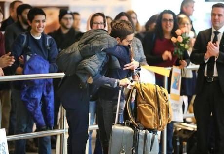 Boston-02/03/2017 . WPI student Behnam Partopour from Iran is is greeted at Logan Airport. There was a welcoming for arriving refugees and immigrants at Logan Airport international terminal, who were previously not allowed to fly to Boston. John Tlumacki/The Boston Globe(metro)