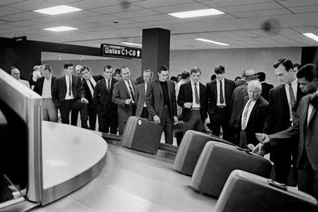FOR MAGAZINE USE ONLY. DO NOT USE BEFORE 2/19 ===== 1967- Boston Red Sox Impossible Dream Season- Frank O'Brien/ Globe Staff -- Returning from an 8-2 win over the Washington Senators, Red Sox players and the team doctor wait for luggage at Logan Airport in Boston.
