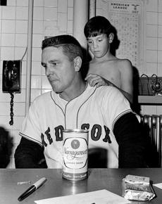 FOR MAGAZINE USE ONLY. DO NOT USE BEFORE 2/19 ===== 1967- Boston Red Sox Impossible Dream Season- Frank O'Brien/ Globe Staff Red Sox manager Dick Williams is consoled by son Ricky after the 1967 Series loss to St. Louis.