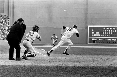 FOR MAGAZINE USE ONLY. DO NOT USE BEFORE 2/19 ===== 1967- Boston Red Sox Impossible Dream Season- Frank O'Brien/ Globe Staff- Jim Lonborg lays down a bunt single to surprise Minnesota and start the pennant willing rally.