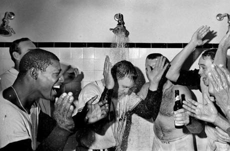 FOR MAGAZINE USE ONLY. DO NOT USE BEFORE 2/19 ===== 1967- Boston Red Sox Impossible Dream Season- Frank O'Brien/ Globe Staff --10/1/67 Sox vs. Twins - Sox Manager Dick Williams gets a shower to celebrate winning the pennant. L to R: Joe Foy, Bucky Brandon, Sparky Lyle and Jose Santiago. *** Right: Celebrating the Sox' pennant win, (from left) third baseman Joe Foy and pitchers Bucky Brandon, Sparky Lyle, and Jose Santiago turn the water on manager Dick Williams.