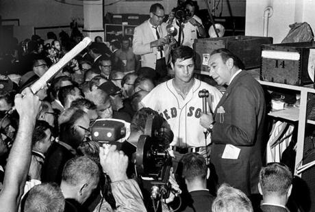 "FOR MAGAZINE USE ONLY. DO NOT USE BEFORE 2/19 ===== 1967- Boston Red Sox Impossible Dream Season- Frank O'Brien/ Globe Staff Sportscaster Howard Cosell interviews left fielder Carl Yastrzemski after Game 2 of the World Series, a 5-0 win over the Cardinals. ""He was superhuman. Everything he did turned to gold,"" retired Globe photographer Frank O'Brien says of Yaz."