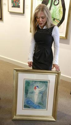 Galerie d'Orsay co-owner Sallie Hirshberg with one of the paintings that was stolen, then recovered.