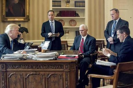 President Trump was accompanied by (from left) Chief of Staff Reince Priebus, Vice Prsident Mike Pence, press secretary Sean Spicer and Flynn on Jan. 28 during a phone call with Vladimir Putin.