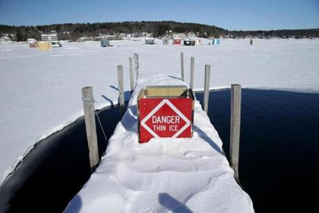 Bob houses dotted Lake Winnipesaukee in mid-February, about a week after three snowmobilers died after falling through thin ice following a spell of warm weather.