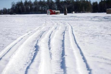 Snowmobile tracks on Lake Winnipesaukee.
