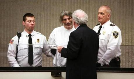 Michael Hebb (center) was arraigned Tuesday morning in the Peabody double murder.