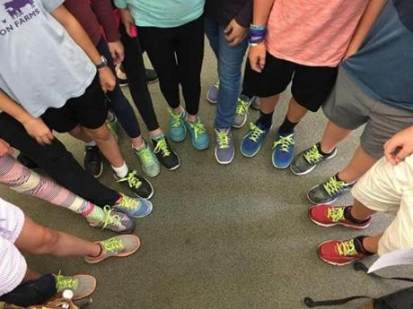 Classmates of Talia's show off their new Cure CMT4J shoelaces. The laces were part of a fundraising effort led by the foundation.