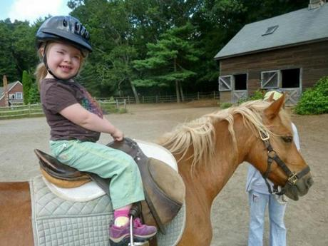 Talia and her horse, Monty, at Affinity Riding Academy during the summer of 2013. Prior to breaking her leg, Talia enjoyed assisted horseback riding.