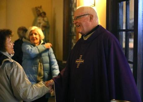 Father Daly was greeted after he celebrated Mass at South Boston's Gate of Heaven Church.