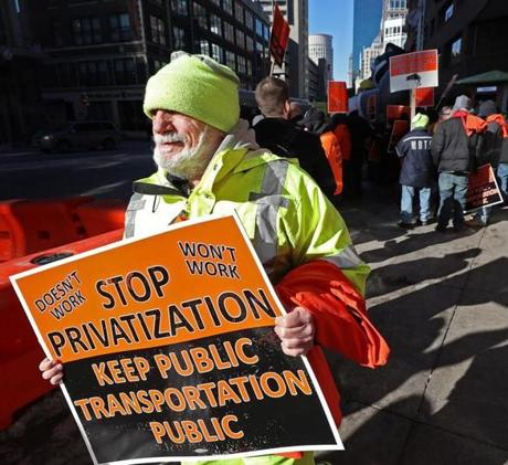 Bus mechanics protested outside the Transportation Building downtown.