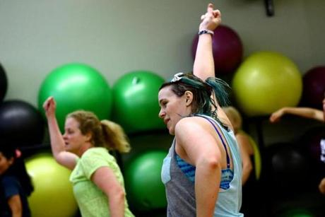 Crystal Tavares leads her Zumba class Sunday morning at the Lynch van Otterloo YMCA, located in Marblehead. Mark Lorenz for The Boston Globe