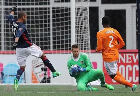 Teal Bunbury has his shot on goal denied by Houston Dynamo goalie Tyler Deric during second half of New England's 2-0 victory Saturday in Foxborough.
