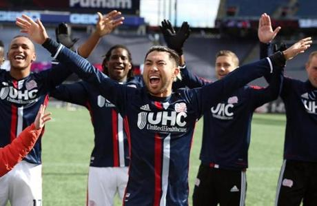 Lee Ngyuen  leads his Revolution teammates in thanking the fans after New England ran its win streak to three consecutive games with Saturday's 2-0 shutout over the Houston Dynamo