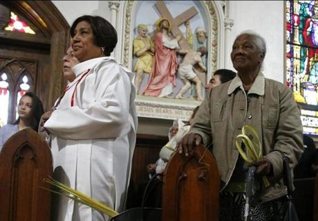 Parishioners held palms during Palm Sunday mass at St. Rose of Lima church.