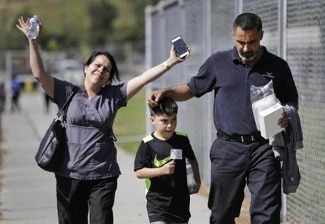 Adrian Velasco, a 7-year-old student at North Park Elementary School, walked with his parents after they were reunited Monday.