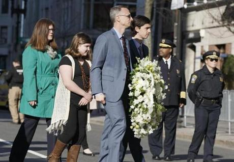 Family members of Marathon bombing victim Martin Richard arrived to place a wreath at 755 Boylston St. during a ceremony on Saturday.