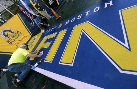 Workers made final preparations of the finish line in Boston on Monday morning.