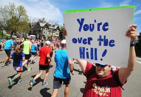 Chris Teager of Mont Clare, NJ, offered support to runners at Heartbreak Hill.