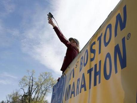 Kathrine Switzer, who was the first official woman entrant in the Boston Marathon 50 years ago, prepared to fire the gun to start the women's elite division race.