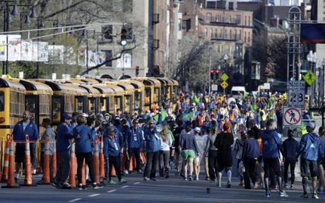 Runners gathered in Boston to board buses for the starting line in Hopkinton.