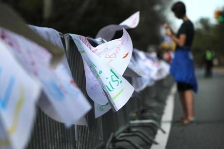 A gentle wind lifted the signs made by Wellesley College students along the race route.