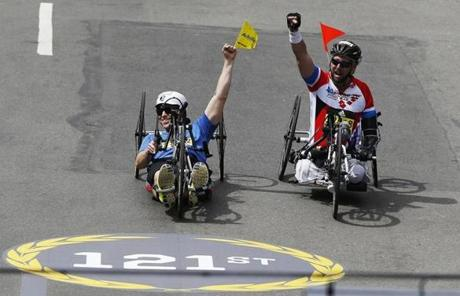 Bombing survivor Patrick Downes, left, crossed the finish line.