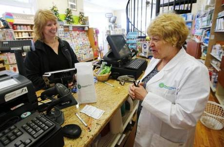 Owner Tracie Ezzio shared a laugh with customer Lynne Henderson in the Pepperell Family Pharmacy.