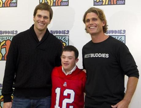 Tom Brady (left) and Anthony K. Shriver (right), with Chris Harrington, at a Best Buddies event in Boston.