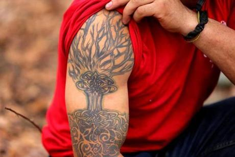 Alex Schwan had a tree of life tattoo on his arm.